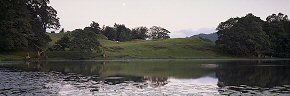 moon above loughrigg tarn