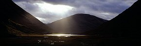 light on loch atriochtan, glencoe
